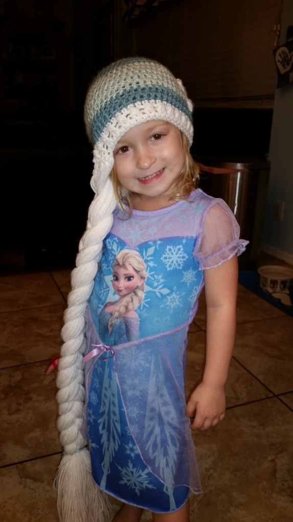 Lulu, in an Elsa nightgown, wearing the one and only Elsa hat.  (even when it's 110 degree outside...).